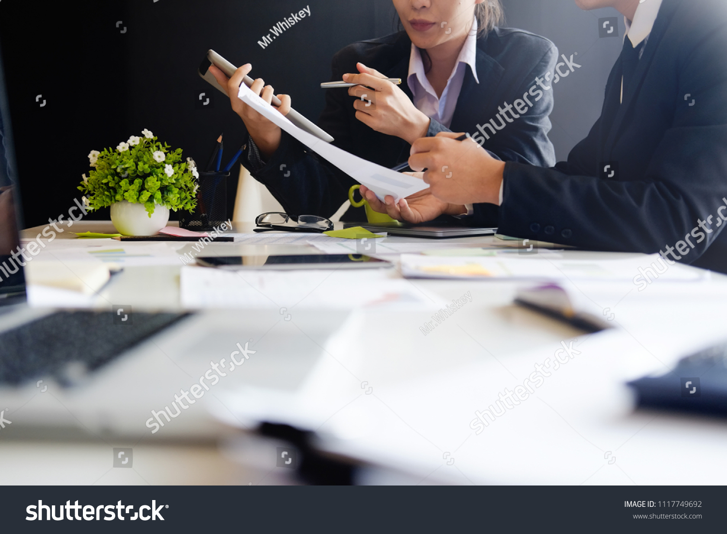 stock-photo-business-concept-audit-team-working-with-tablet-computer-and-paper-report-in-finance-office-1117749692